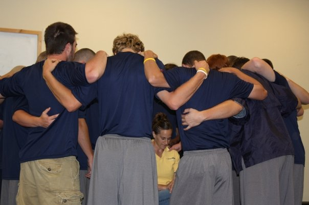 AIA Fellas praying over Natalie (Jonny Mac's wife) after she shares her 3 H's (hero, hardship & highlight) and gives the guys a womans perspective on relationshsips