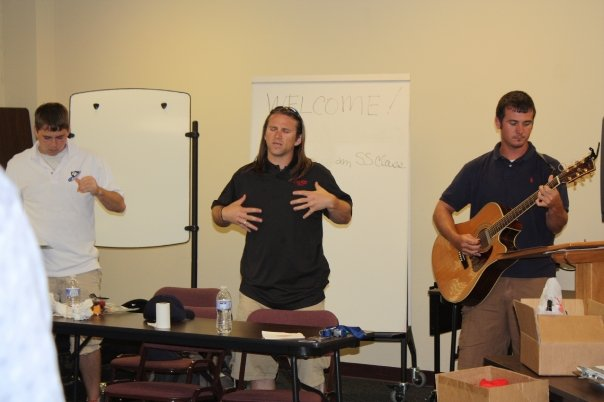 Our discipleship time, one of our players (Doc) leading worship with guitar and me getting my praise on.